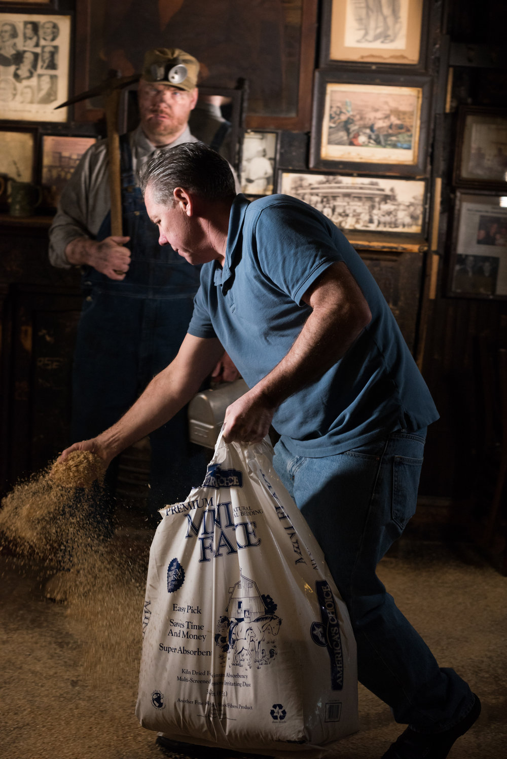 McSorley's manager spreads some saw dust for the shot.