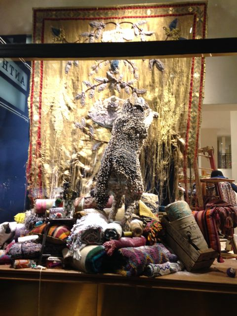 Gorgeous juxtaposition of a wolf scaling a beautifully woven textile, shredding the material as she moves upward.