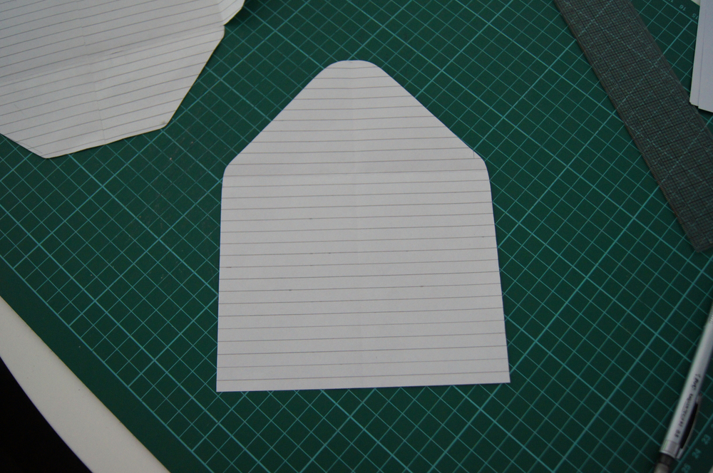 After you have made the template for the shell (navy part), you need to make one for the inside that we shall be using the gold polka dot cardstock for. To do this, I used the above finished template that we are using for the navy shell and traced around just the back section as you can see above on another piece of paper.I then made it a bit smaller so you can see a thin blue strip around the edges. The best way to do this, is to decide how thick you would like the strip and then with a ruler evenly measure around the template, cut along the new line, and then fold the template in half to make sure the sides are perfectly even; and do any trimming if needed.