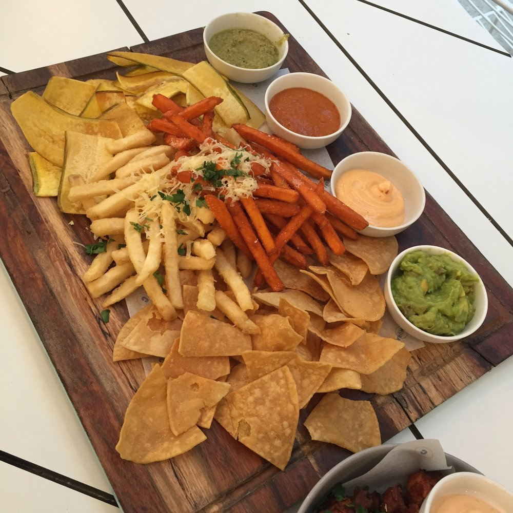 MARKET TREATS - Chips Tasting Board: selection of potato, sweet potato, corn chips and plantains with guacamole and chipotle aioli