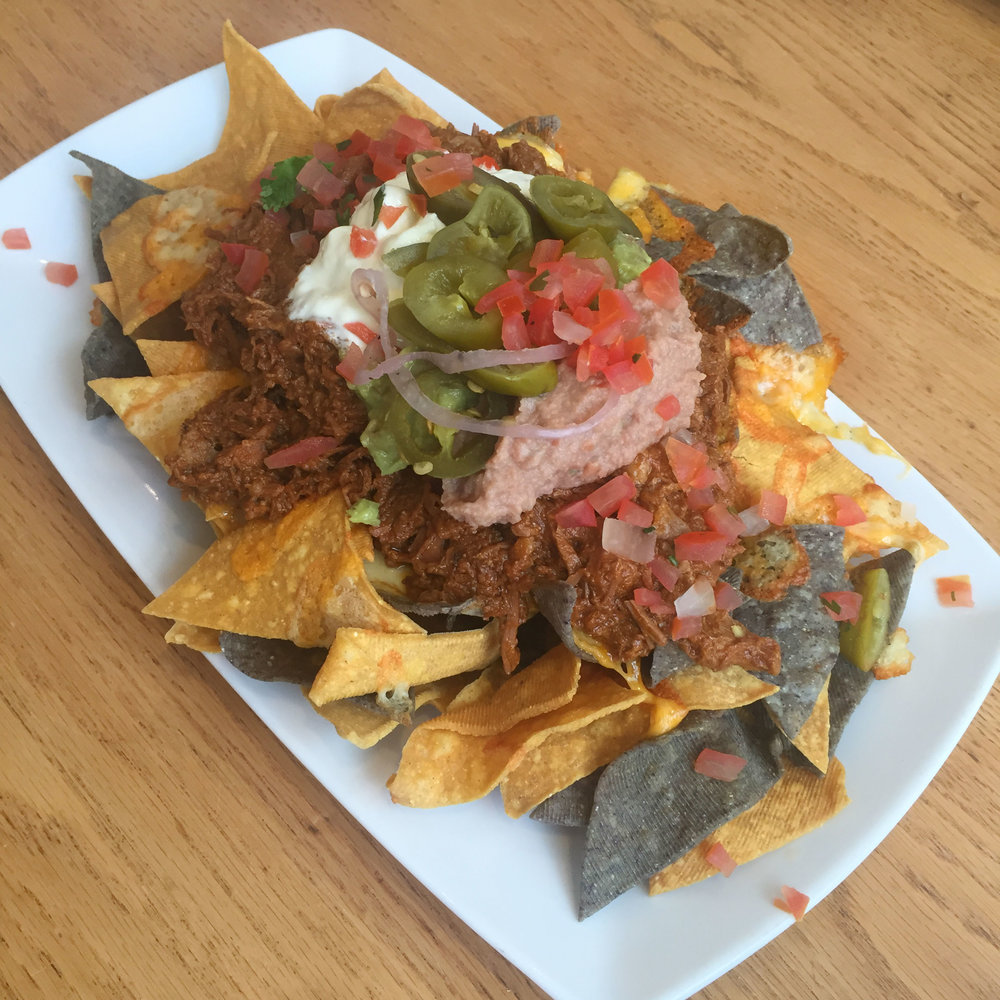 Noosa Beach House Peter Kuruvita Day Bar : Beef Nachos with Mexican cheese, tomato salsa, sour cream and beans