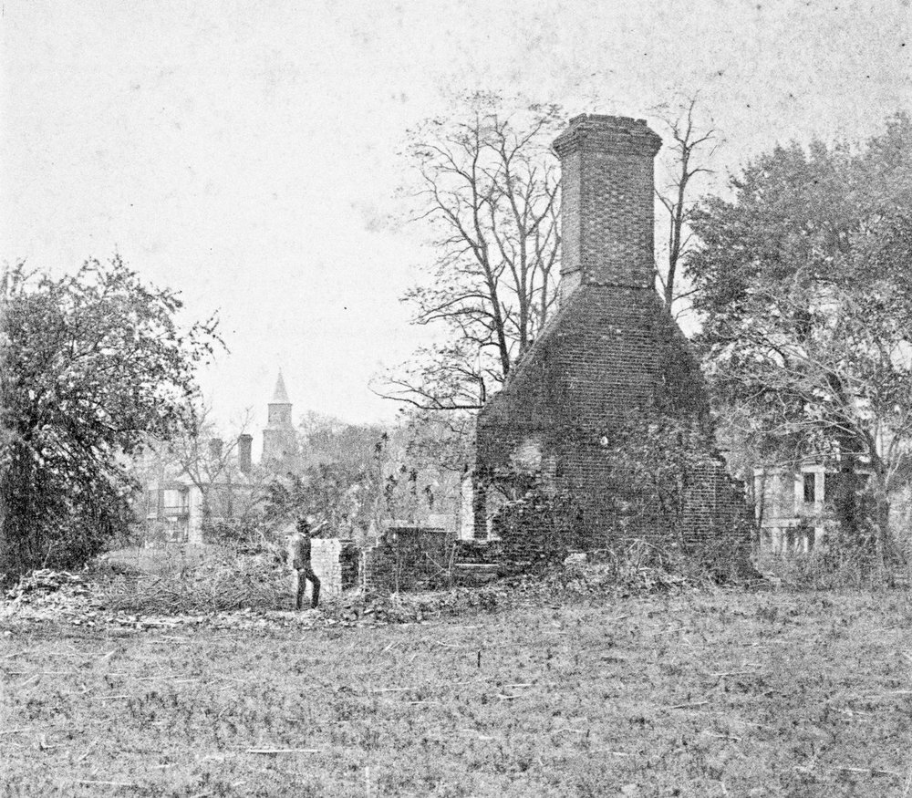 View from south of the ruins of the Palace West Advance with George Wythe House and Bruton Parish Church in left background and Robert Saunders House in right background, ca. 1900