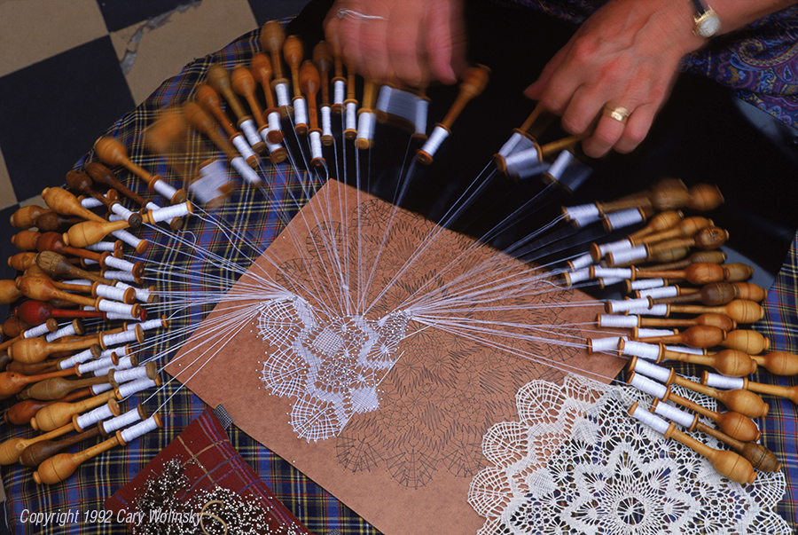 Lace making. A woman makes cotton lace using 74 bobbins in Brugge, Belgium.