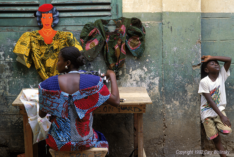 A seamstress using a sewing machine on the streets of Accra, Ghana.