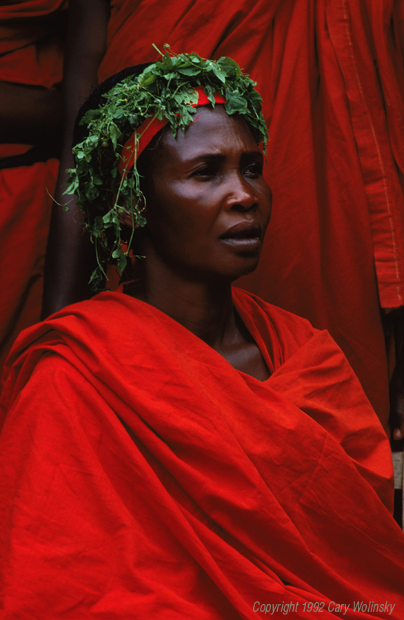 A woman wears red cloth to attend a funeral in Ghana, Africa.