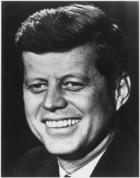 It's John F. Kennedy, in case you live under a rock or don't know the face of our first photogenic President (Franklin Pierce excepted, of course). Public Domain. 1961.