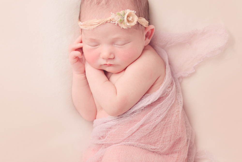 side pose - sleeping beauty - handmade newborn wrap - peach tieback - Louisa Nickel Photography