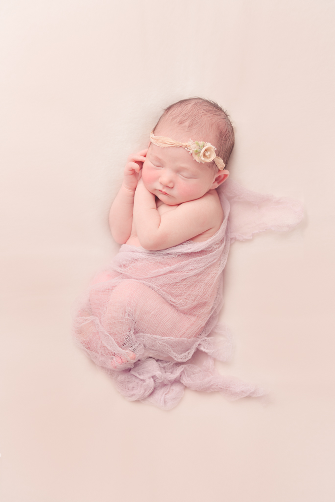 side pose - handmade purple newborn wrap - peach tieback - Louisa Nickel Photography