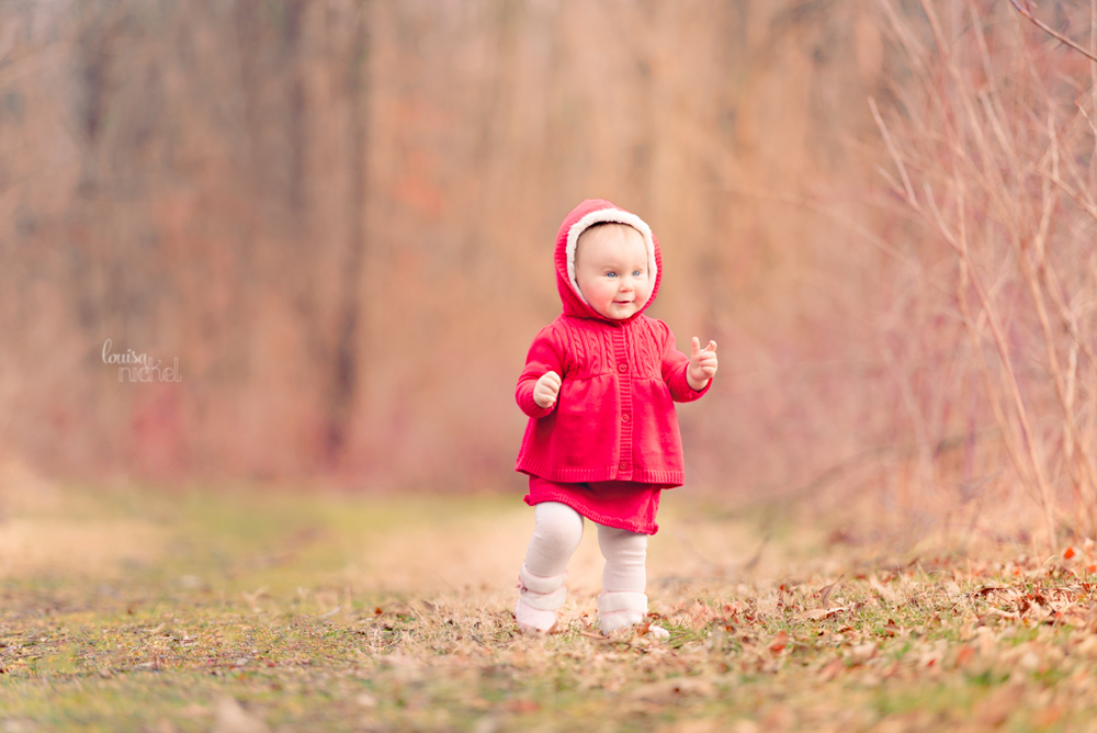 baby girl - walking in forest - red coat - 11 months - Louisa Nickel Photography