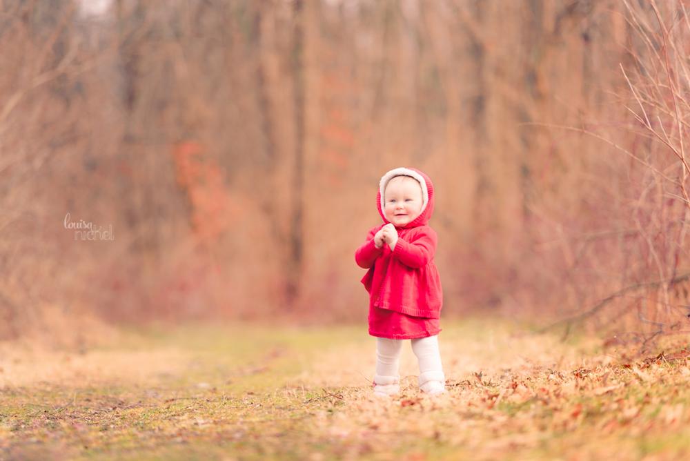 walking baby - red coat - woods - winter - Louisa Nickel Photography