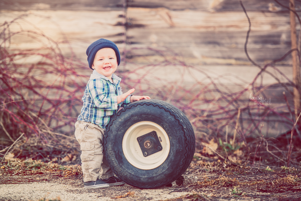 baby boy - tire prop - barn - outdoor - Cherry Valley, IL - Louisa Nickel Photography