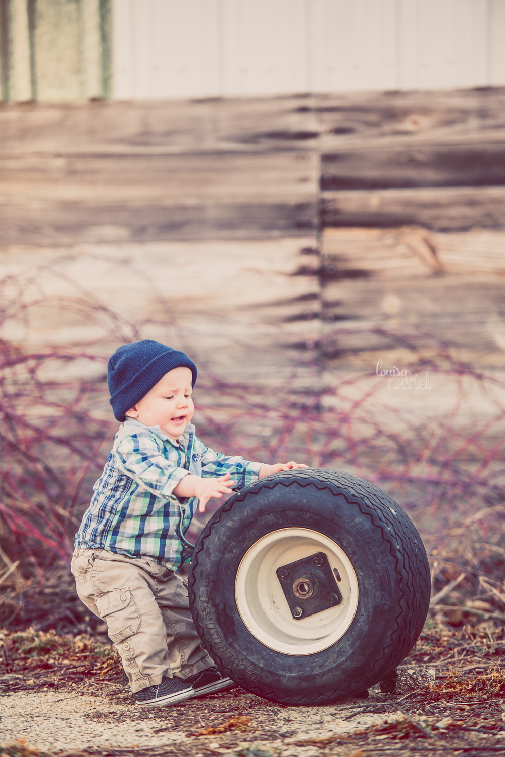 baby boy - barn wood - rolling tire - Rockford, IL - Louisa Nickel Photography