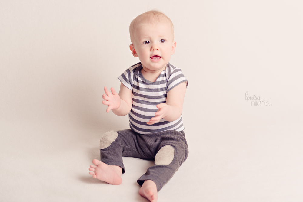 clapping hands - sitter session - handmade baby pants - Louisa Nickel Photography