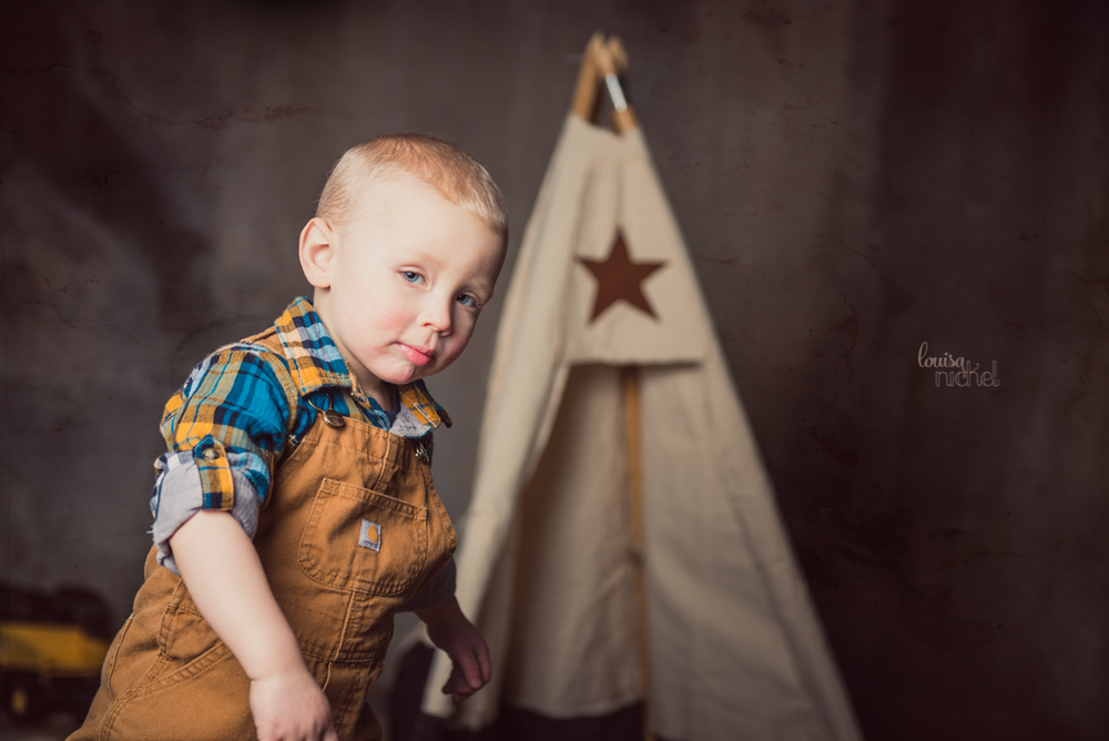 two year old pose - rugged farm boy - carhartt overalls - Louisa Nickel Photography