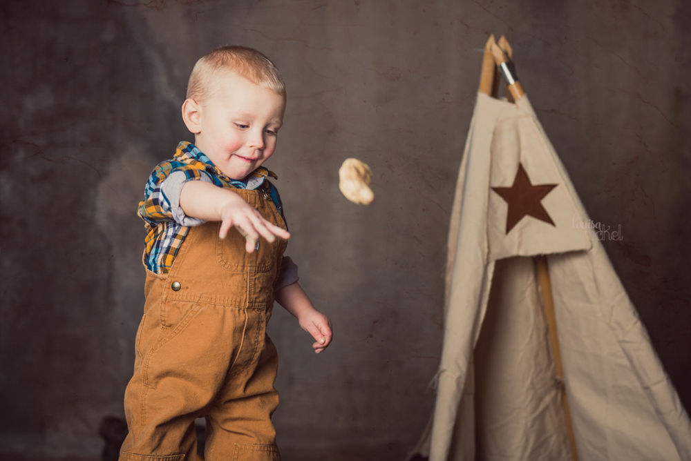 throwing rocks - teepee - 2 year old session - Louisa Nickel Photography