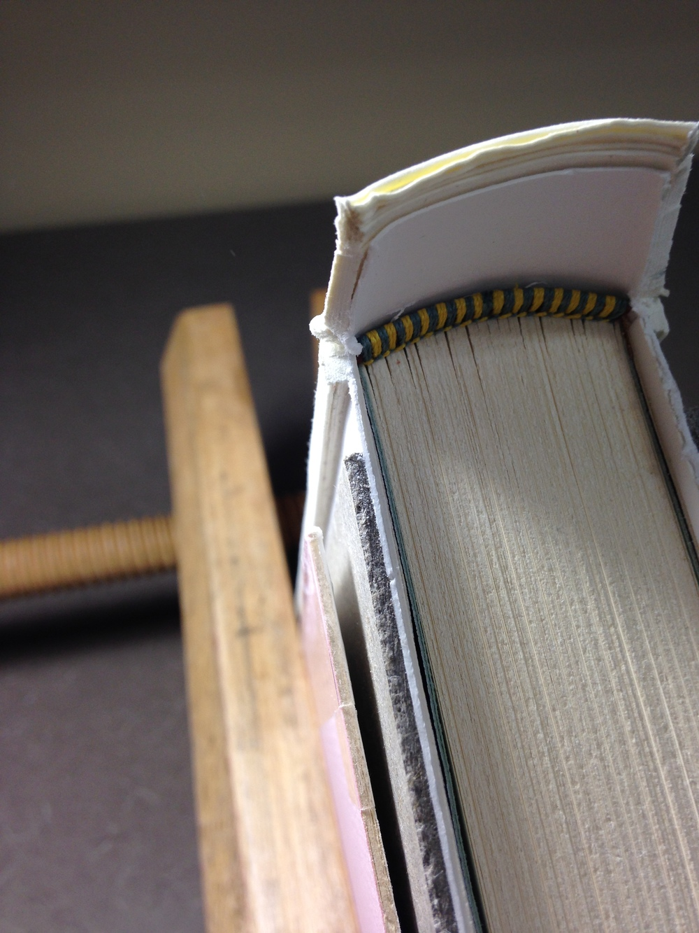 I used a serrated saw in combination with the cleaner-cut of a smooth edge paper knife to remove the excess material.