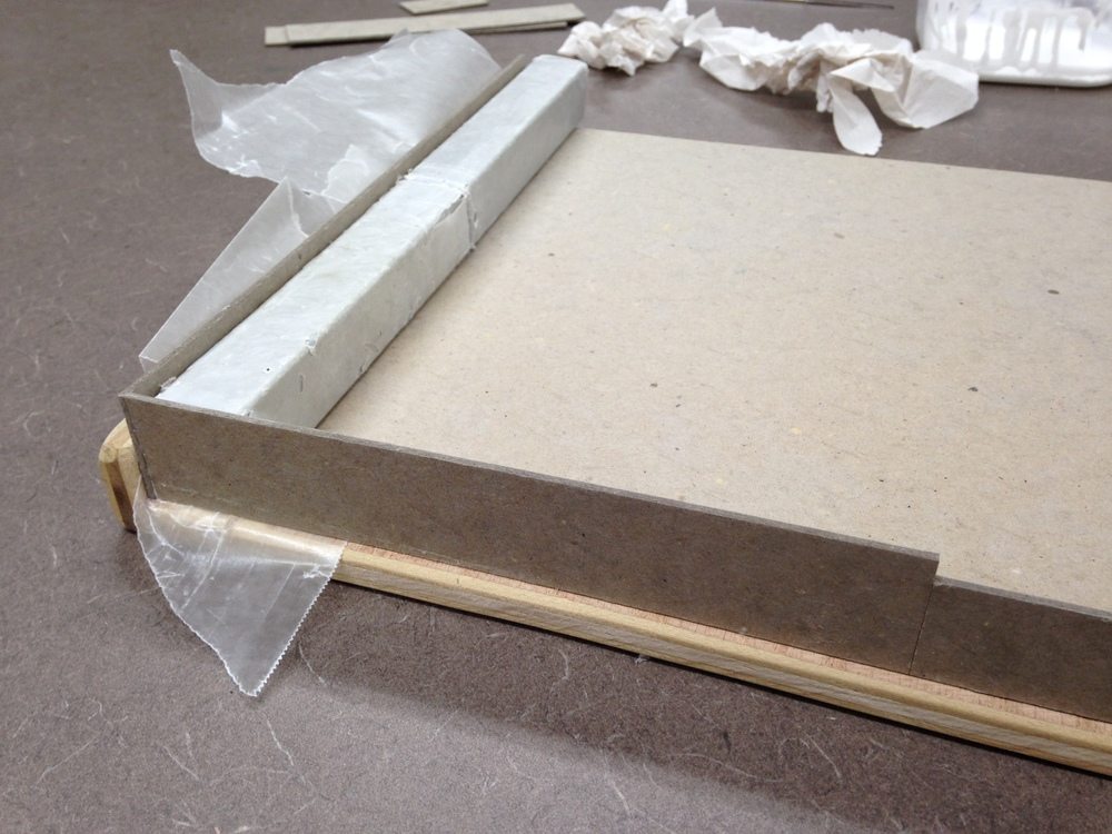 The cutout opening on the side of the inner tray is built using a separate piece of binders board.