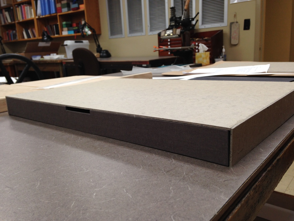 This outer tray will fit snugly over the inner tray after covered in cloth.