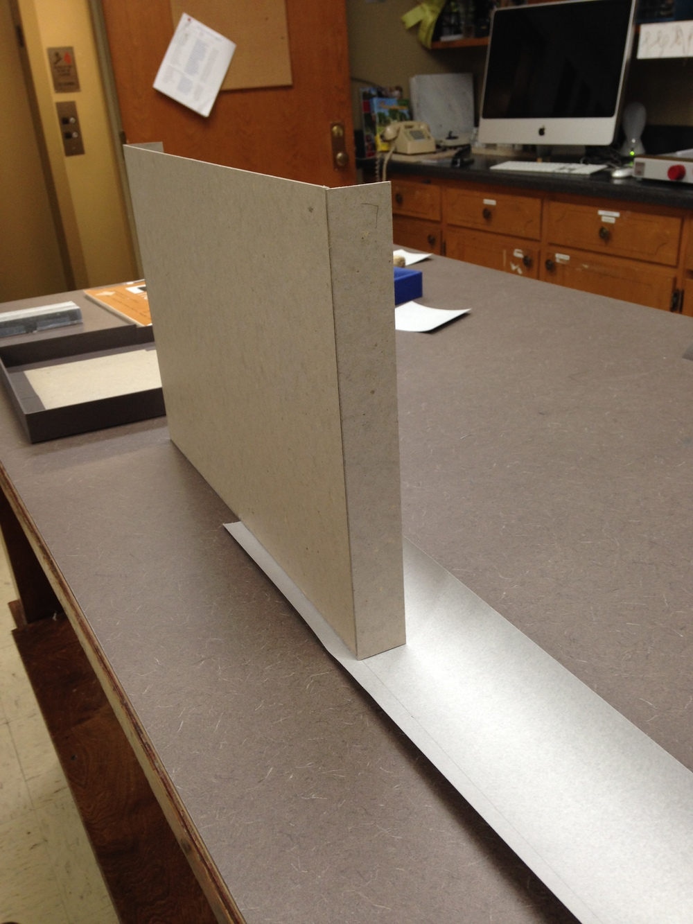 Covering the outer tray in cloth