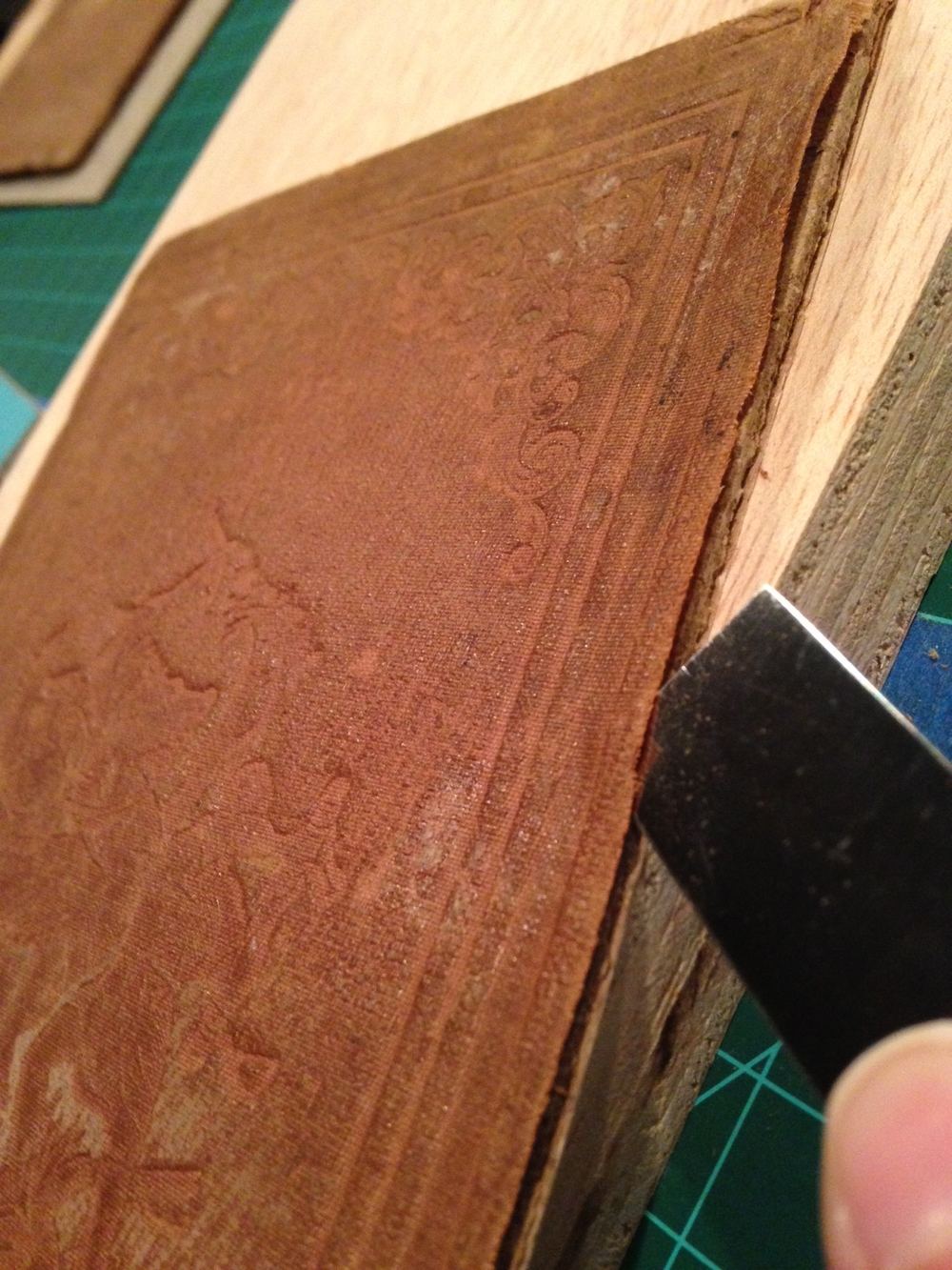 Then I was able to use the paper knife in semicircular motions to continue lifting the material further away from the board edge