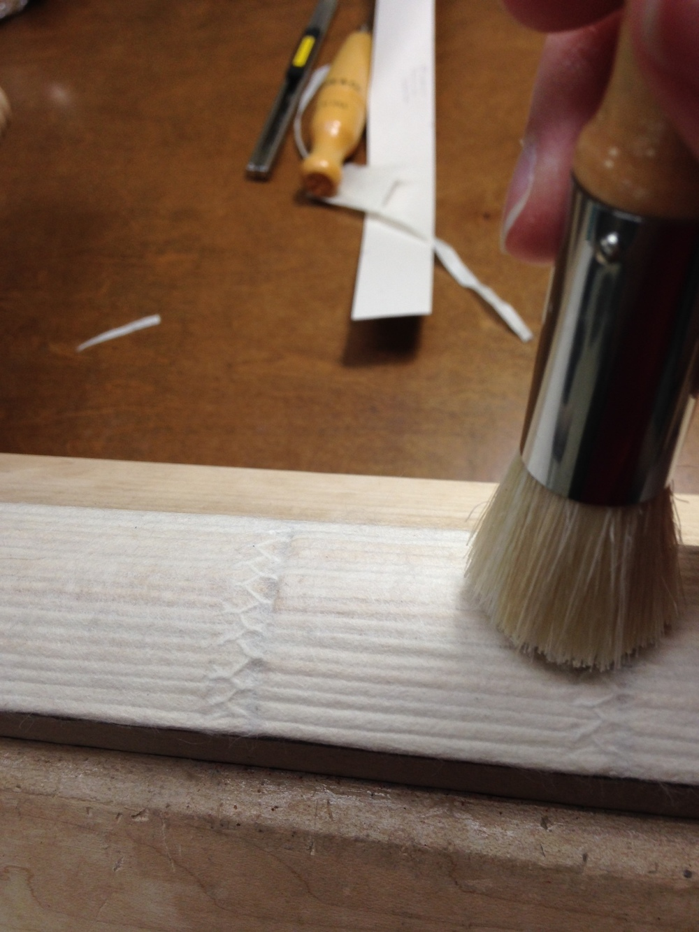 The first spine lining was applied using paste and a stipple brush to ensure good adhesion.
