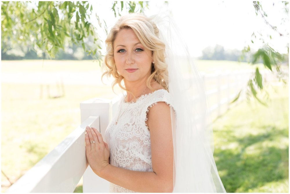White fence and willow tree bridal portrait on Lancaster PA family farm wedding photo