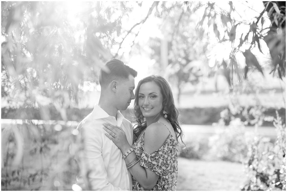 Lancaster PA engagement session at golden hour by mill and willow tree black and white photo