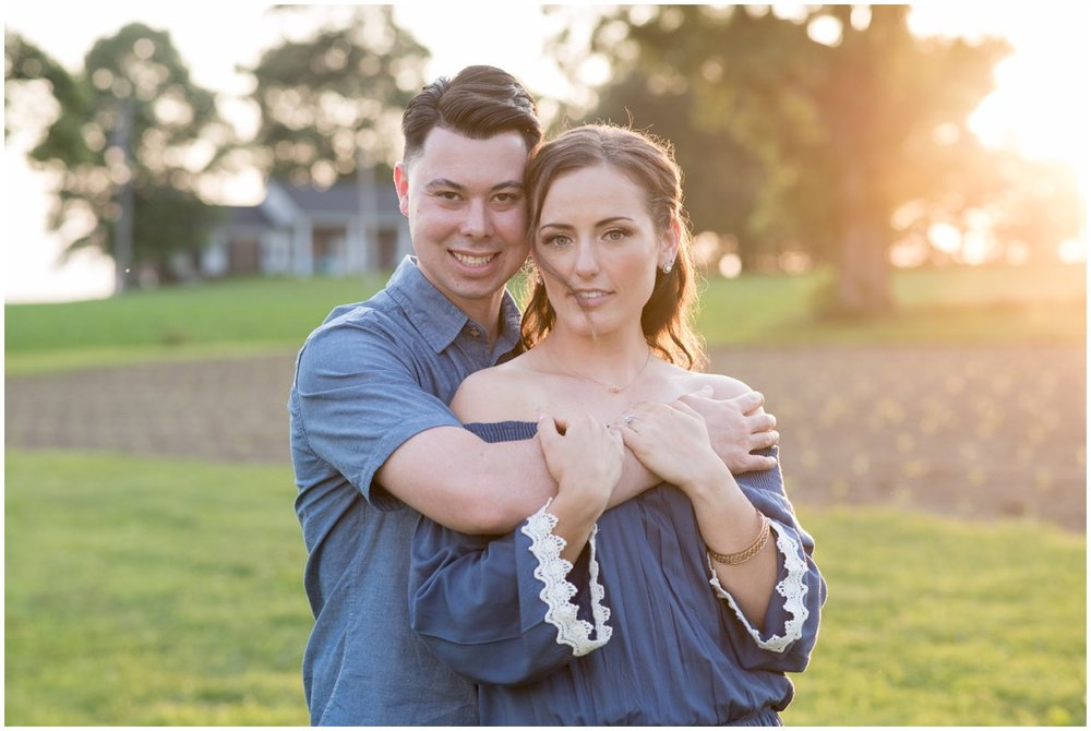 Lancaster County farm engagement session at golden hour in field photo