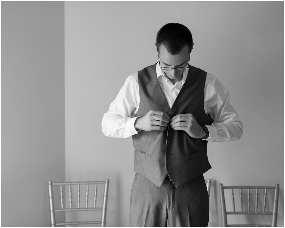 Groom getting ready on wedding day at Pheasant Run Bed and Breakfast in Lancaster PA photo