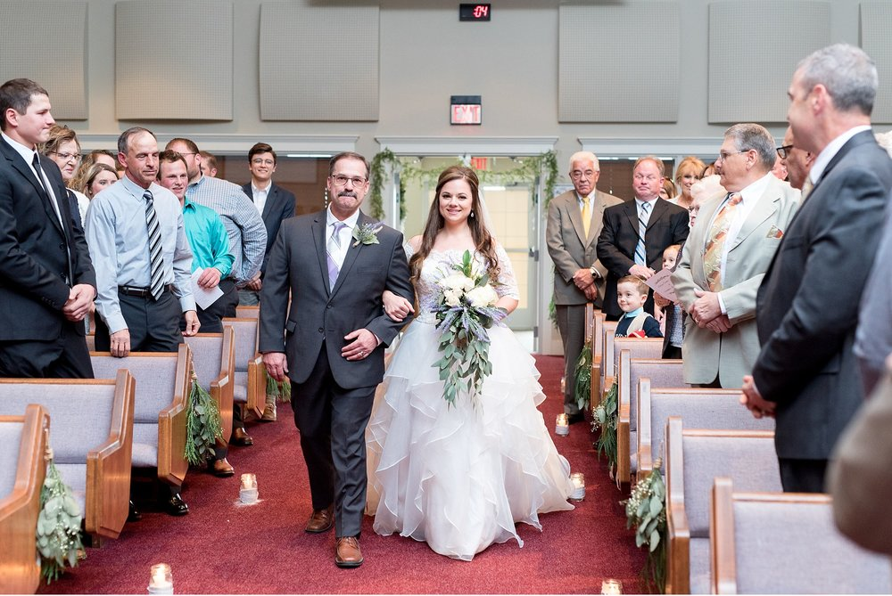 Christian Fellowship Church wedding bride coming down the aisle photo