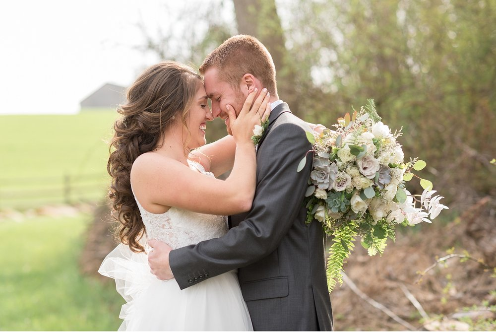 Bride-and-groom-embracing-nose-to-nose-in-Lancaster-County-Wedding-Photography