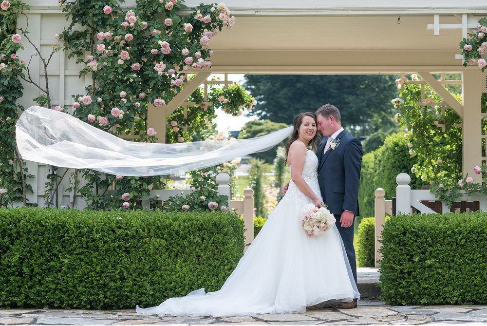Bride and groom with blowing veil Hershey Gardens Hershey Country Club Summer beautiful wedding photography_1594.jpg