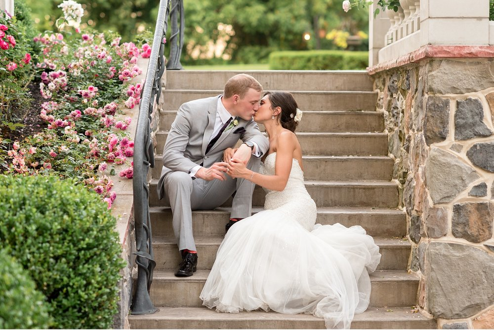 Bride-and-groom-sitting-on-steps-at-Moonstone-Manor-Elizabethtown-PA-Wedding-Photography