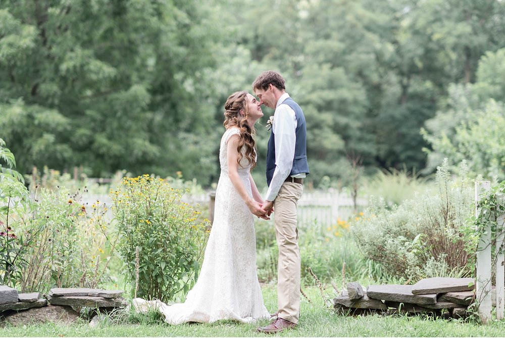 bride and groom in gardens of Landis Valley Farm Museum Lancaster Wedding Photography photo