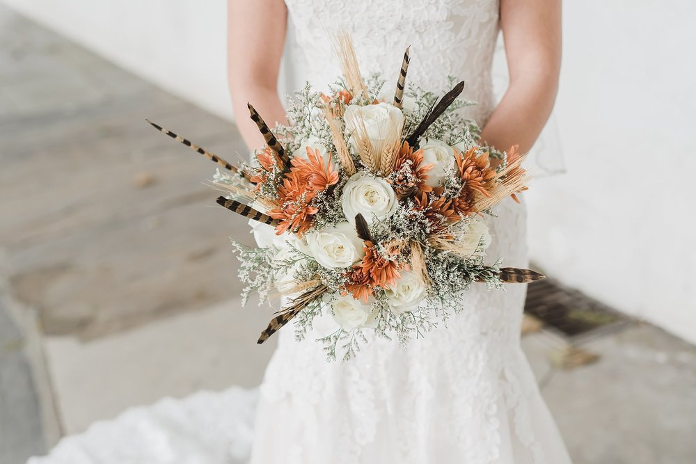 Bridal bouquet with feathers Lancaster County wedding photography photo