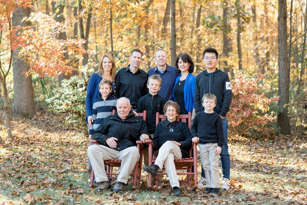 large family gathered in leaves portrait photography