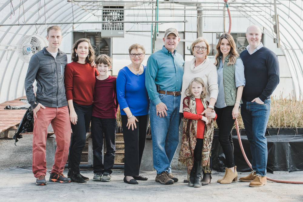 large family in greenhouse portrait photography Lancaster PA