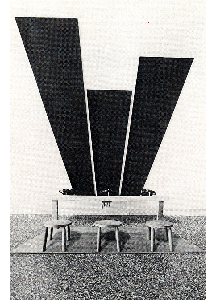 sculpture-center :     FROM THE ARCHIVES: Sound/Art, 1984. SculptureCenter, New York. Vito Acconci,  Three Columns for America , 1976. Wood, table, stools, headphones, sound. Dimensions variable. Image courtesy the artist.