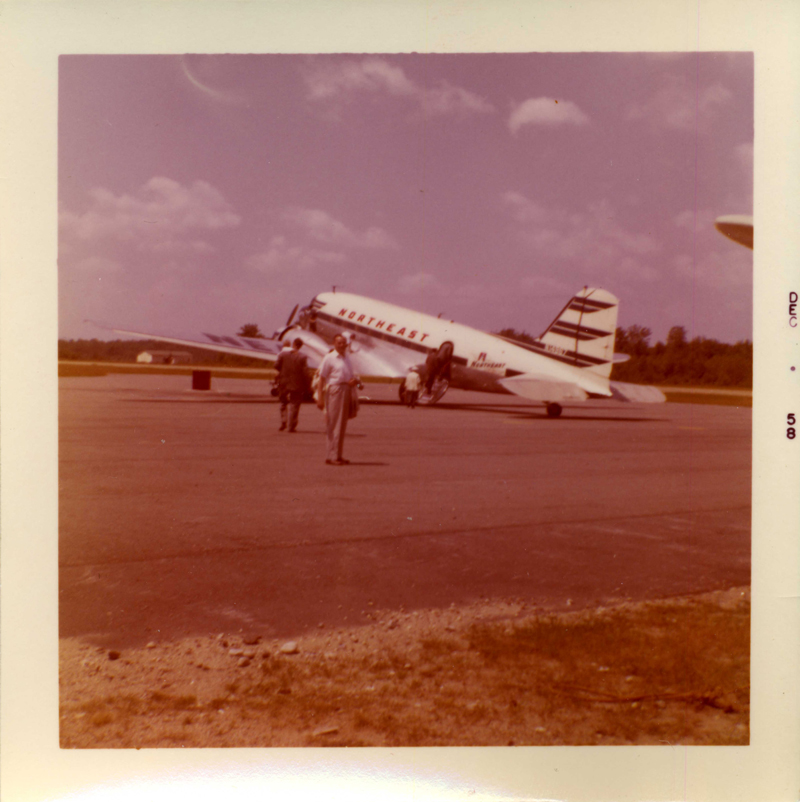 "December, 1958.   Written on the back:    ""Laconia airport - Daddy [my grandfather] leaving for N.Y. The plane was held up for a while - some deer were on the runway."""
