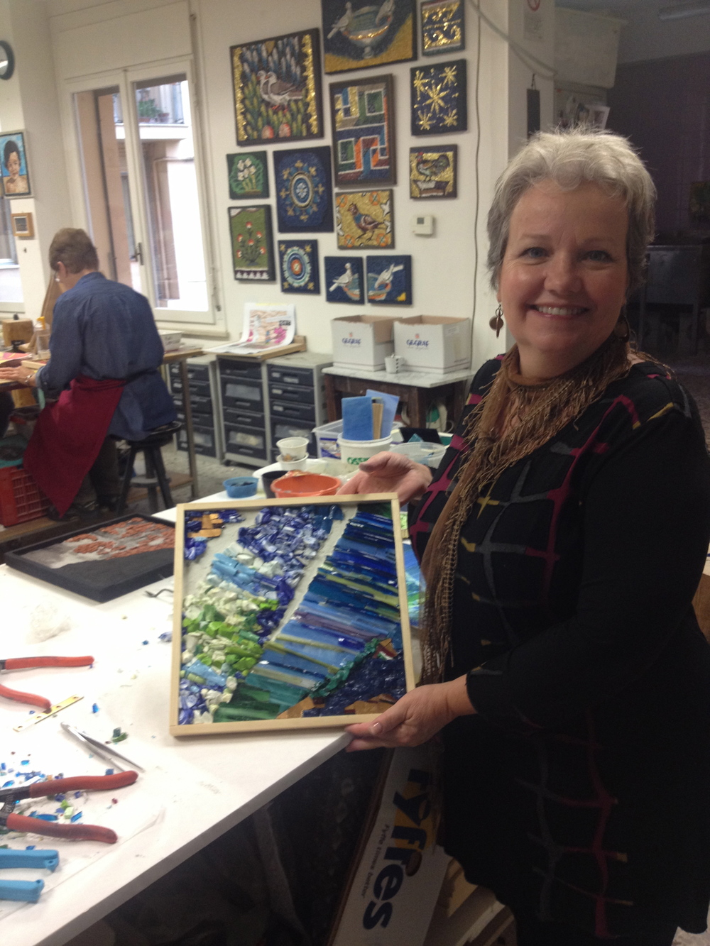 Two-time tour participant Margy Cottingham shows the work created from her own painting during the KokoMosaico workshop in October, 2015.