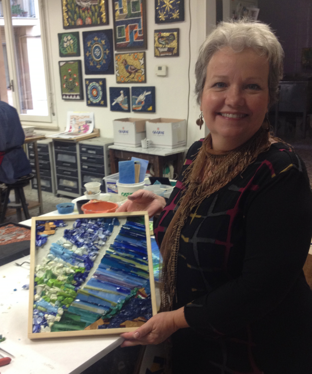 Margy, on her second Mosaic Masterpieces Tour, with a piece she made during an exclusive tour workshop at Kokomosaico. She used her own painting for inspiration.