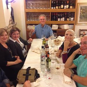 Happy diners stay late to bond over one last glass of limoncello in Rome.