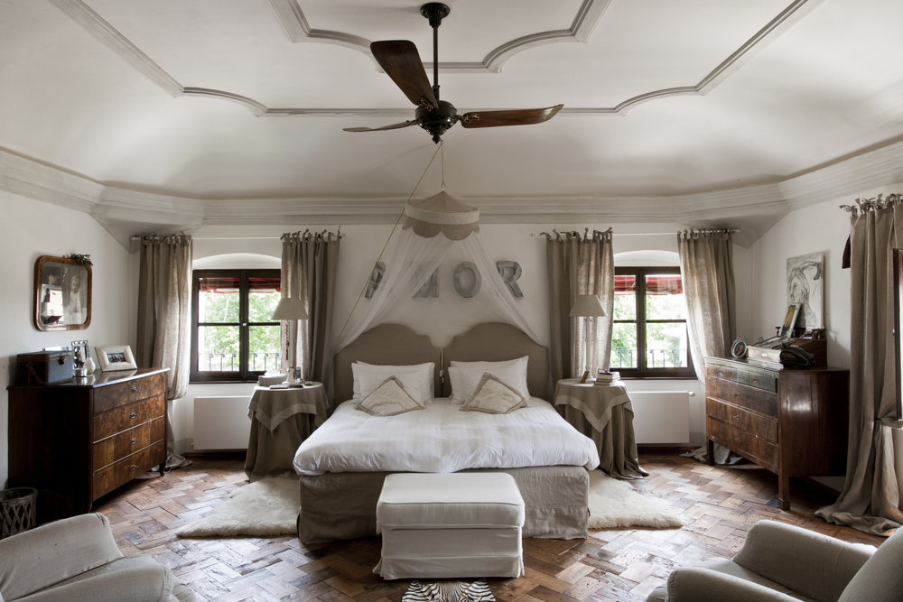 One of six elegant bedrooms.