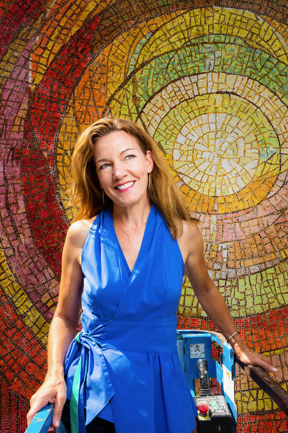 Julie pictured with the Gyorgy Kepes-designed mosaic at St. Jude Chapel in Dallas during restoration in June, 2017. Photo courtesy of Danny Fulgencio, DannyFulgencio.com