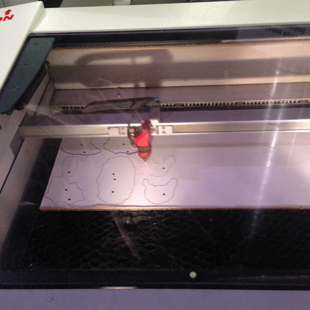 Laser cutting slices for the Taung Child crania.  (photo: L. Pyne)