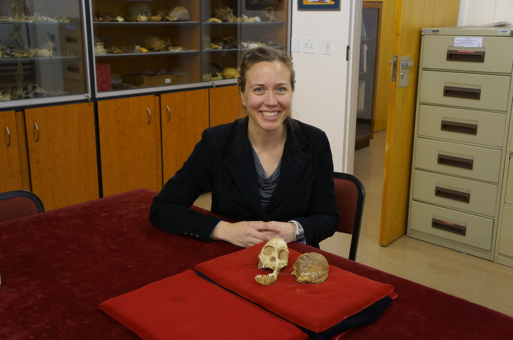 Lydia Pyne with Taung Child fossil. Photo: B. Zipfel, courtesy of University of the Witwatersrand