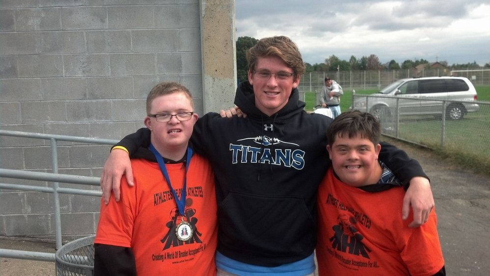 We just got this note and photo of a mini reunion from Camp PALS camper Jake Klouser:    Kevin (Grow) and I were the Honorary Captains for Archbishop Ryan's football team. Tyler (McGee) was watching his cousin play. I love you guys. Go Camp PALS.    Thanks for sharing, Jake! We love to hear from anyone with news like this.