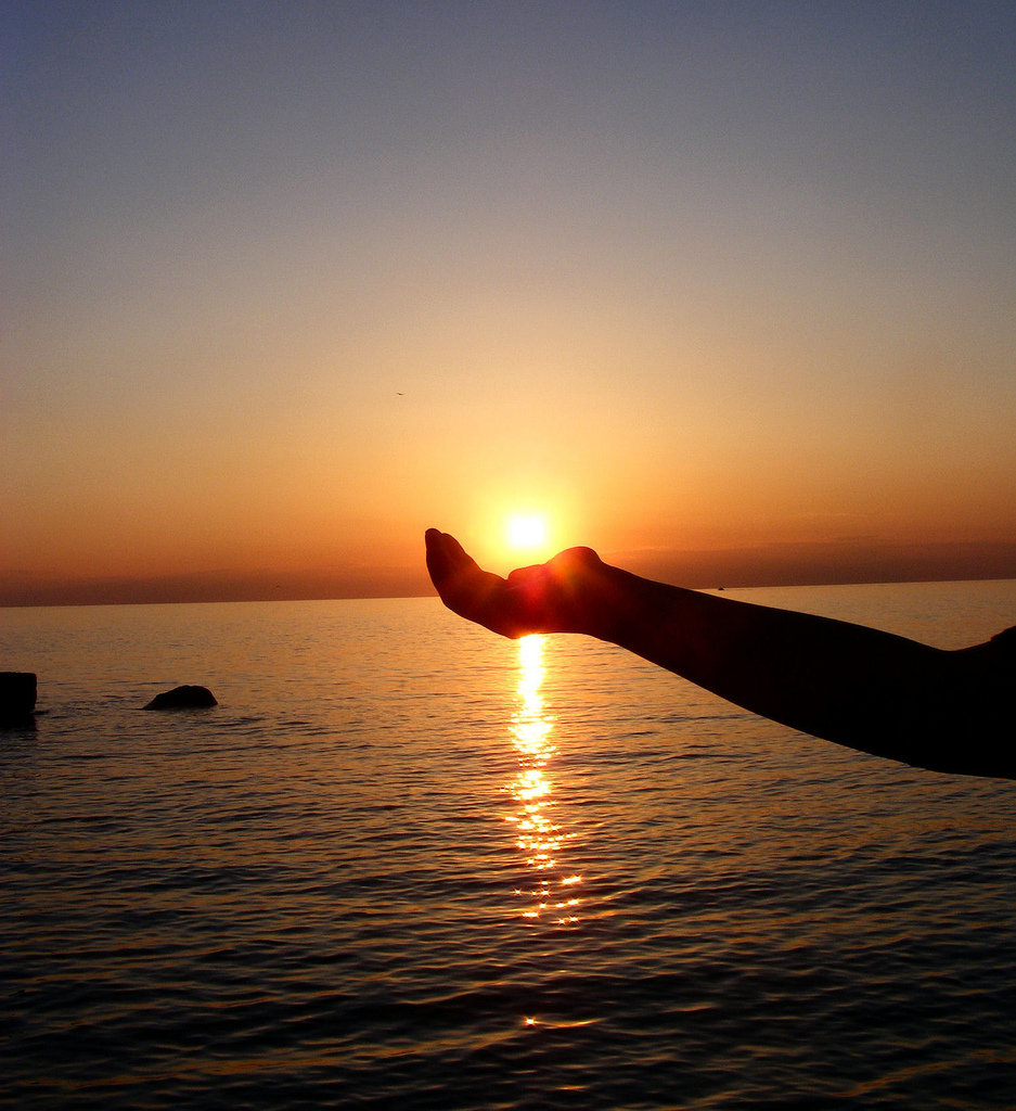 hand holding the sun.jpg