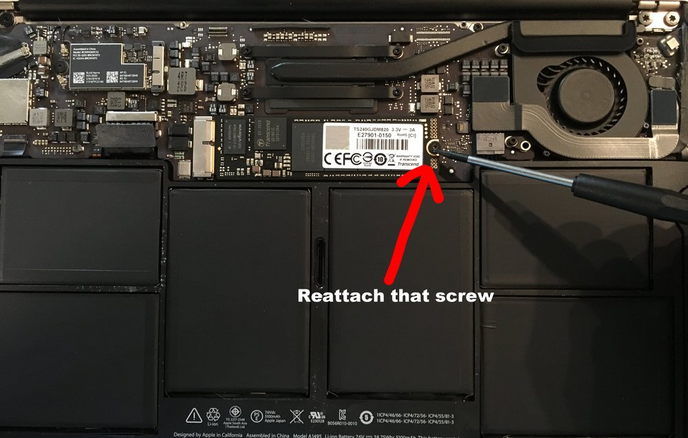 Reattach the screw holding the SSD using the provided screwdriver
