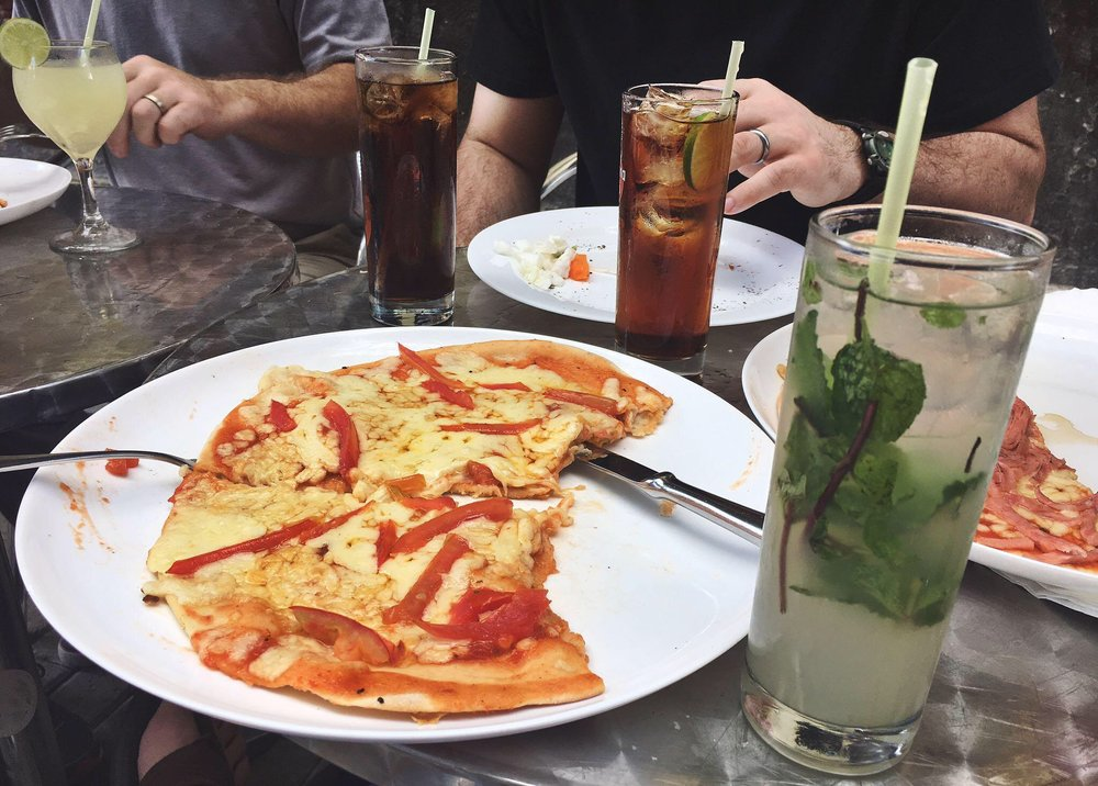 Cuban street pizza and a mojito. Total cost = 6 CUC